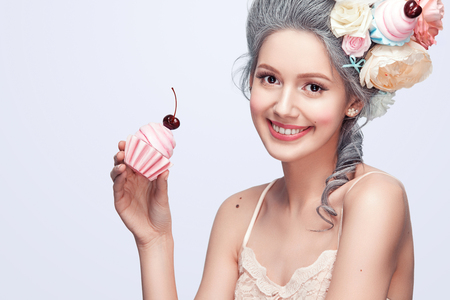 Beautiful blonde woman with a cake. Sweet sexy lady. Vintage style. Fashion photo