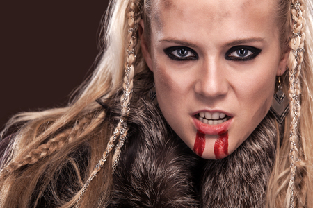 Viking woman in a traditional warrior clothes. Stock Photo