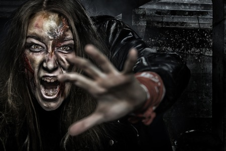 Close-up portrait of horrible zombie woman with wounds. Horror. Halloween poster. Stock Photo