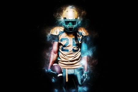 American football sportsman player isolated on black background
