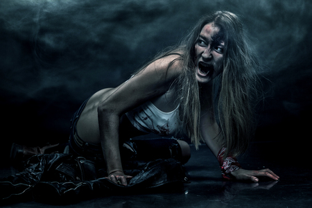 Zombie woman, Horror background for halloween concept and book cover. Copy space.