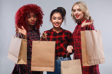 Three women at shopping on Black Friday holiday.