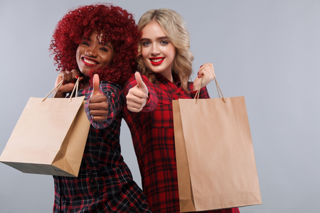 Two women at shopping on Black Friday holiday. Lizenzfreie Bilder