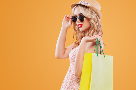 Woman at shopping holding bag on black friday holiday. Copy space for sale ads. Lizenzfreie Bilder