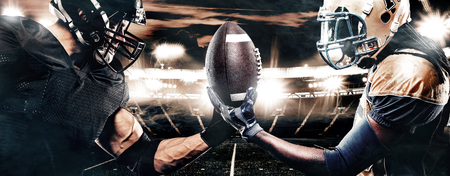 Two american football sportsman players on stadium. Sport concept. Stock Photo