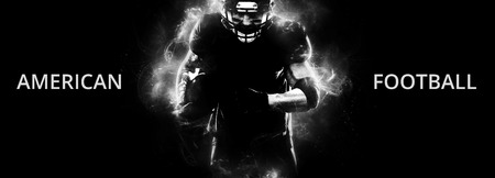 American football sportsman player on black background running in action. Sport wallpaper with copyspace.