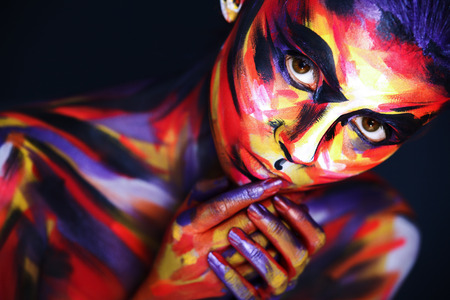 Portrait of the bright beautiful girl with art colorful make-up and bodyart Stock Photo