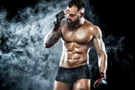 Sportsman boxer fighting on black background with smoke. Copy Space. Boxing sport concept. Reklamní fotografie