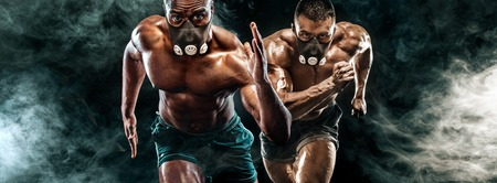 Competition of two strong athletic men sprinters in training mask, running, fitness and sport motivation. Runner concept with copy space. Dynamic movement.