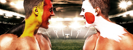Soccer or football fan with bodyart on face with agression - flag of Belgium vs Japan. Banco de Imagens