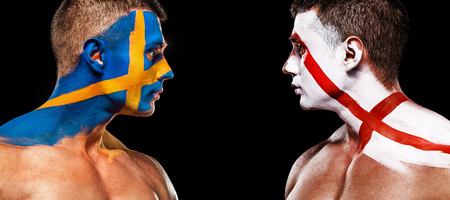 Soccer or football fan with bodyart on face with agression - flags of Sverige, Sweden vs England. Sport Concept with copyspace.