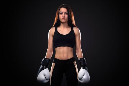 Woman boxer on black background. Boxing and fitness concept. Stockfoto
