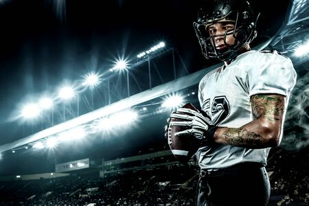 American football sportsman player in helmet on stadium. Sport wallpaper.
