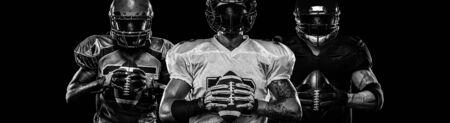 American football player, sportsman in helmet on dark background. Black and white photo. Sport wallpaper.