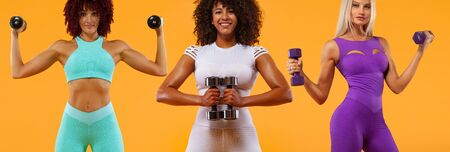 Group of three sporty fit women, athletes with dumbbells makes fitness exercising on yellow background. Fitness and workour motivation.