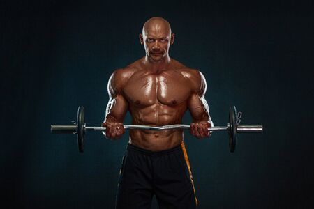 Strong and fit man bodybuilder. Sporty muscular guy with barbell. Sport and fitness motivation. Individual sports recreation. Stockfoto