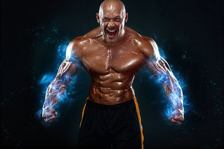 Bodybuilding competitions on the scene. Handsome and fit man sportsmen bodybuilder physique and athlete. Mens fitness and sport motivation. Individual sports recreation.