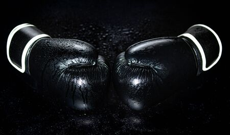 A pair of boxing gloves isolated on a black background