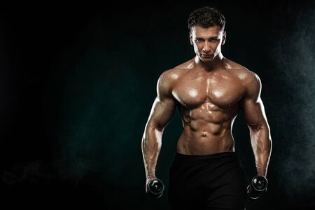 Strong and fit man bodybuilder. Sporty muscular guy with dumbbells. Sport and fitness motivation. Individual sports recreation.
