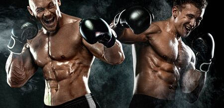 Two men boxers fighting in gloves on black background. Fitness and boxing concept. Individual sports recreation.