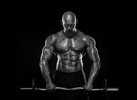 Strong and fit man bodybuilder. Sporty muscular guy with barbell. Sport and fitness motivation. Individual sports recreation. Imagens - 134005510