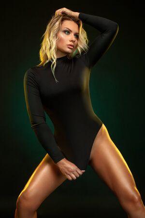 Beautiful blonde girl on a dark background. Imagens