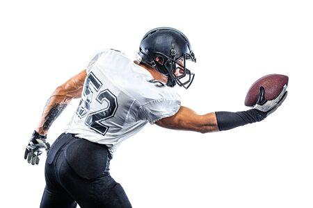 American Football player on stadium with smoke and lights.