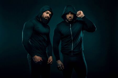 Two Muscular fitness sports men, atletes with in fitness gym.