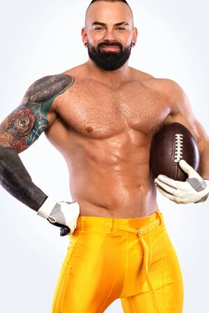 Gay streptizer with naked torso. American football player in helmet isolated on white background. Imagens