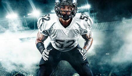 American football player. Sportsman in helmet on stadium. Sport wallpaper. Team sports.