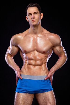 Athlete bodybuilder. Strong and fit man. Sporty muscular guy on black background. Sport and fitness motivation. Imagens