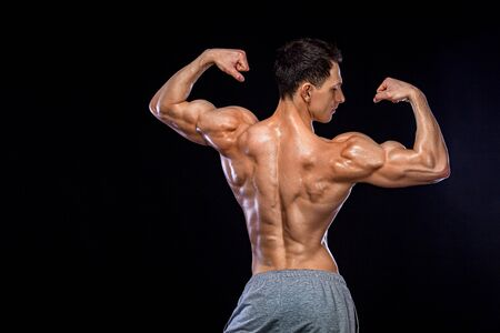 Athlete bodybuilder. Strong and fit man. Sporty muscular guy on black background. Sport and fitness motivation. Individual sports recreation.