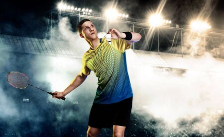 Badminton player in sportswear with racket and shuttlecock on stadium. Individual sports. Sports recreation.