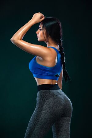 Fit woman athlete, on black background. Fitness and sport motivation. Stock fotó