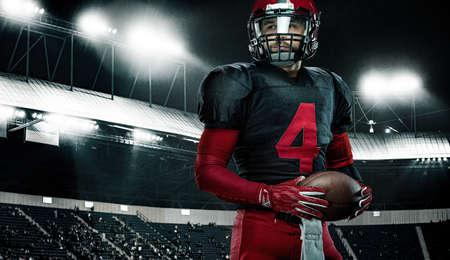American football player, athlete sportsman in red helmet on stadium background. Sport and motivation wallpaper. Archivio Fotografico