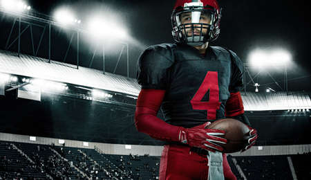 American football player, athlete sportsman in red helmet on stadium background. Sport and motivation wallpaper.