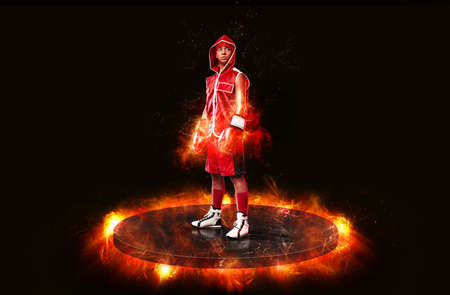 Kids boxing and sport concept. Girl sportsman muay thai boxer fighting in gloves in fire.