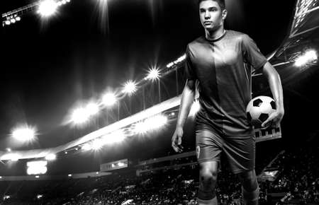 Black and white photo of teenager - soccer player. Man in football sportswear after game with ball. Sport concept.