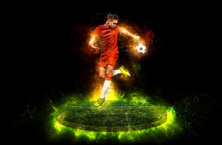 Teenager athlete - soccer player in red t-shirt. Boy in football sportswear in game with ball. Sport concept.
