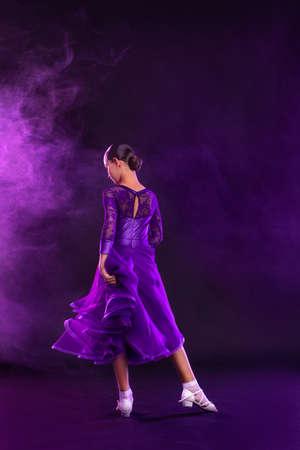 Girl athlete dancing sports ballroom dancing.