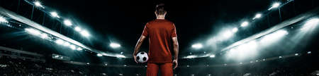 Teenager - soccer player. Man in football sportswear after game with ball. Sport concept. Wide photo.