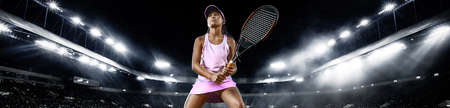 Teenager tennis player. Beautiful girl athlete with racket in pink sporswear and hat on tennis court. Fashion and sport concept. Wide photo.