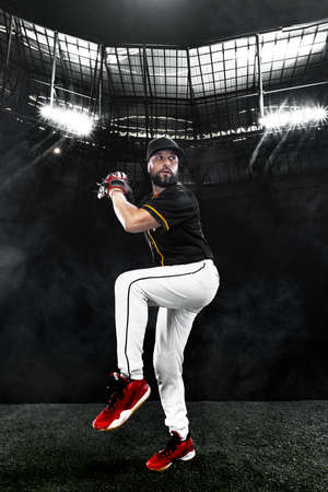 Porfessional baseball player with ball on grand arena. Ballplayer on stadium in action.