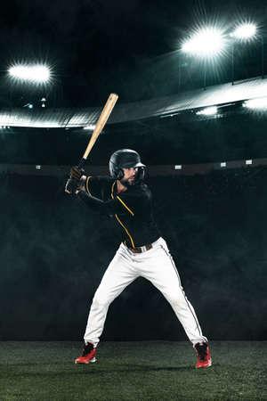 Porfessional baseball player with bat on grand arena. Ballplayer on stadium. Stock Photo
