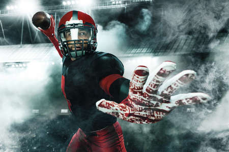 American football player, athlete sportsman in red helmet on grand arena background. Sport and motivation wallpaper.