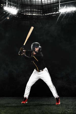 Porfessional baseball player with bat on grand arena. Ballplayer on stadium. 版權商用圖片