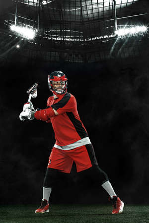 Lacrosse Player, athlete sportsman in red helmet on grand arena background. Sport and motivation wallpaper.