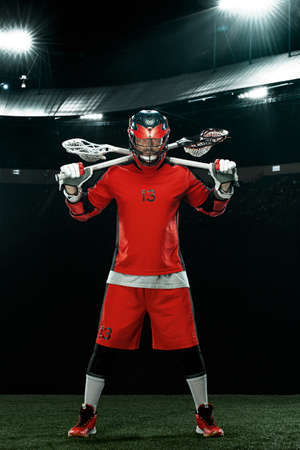 Lacrosse Player, athlete sportsman in red helmet on stadium background. Sport and motivation wallpaper.