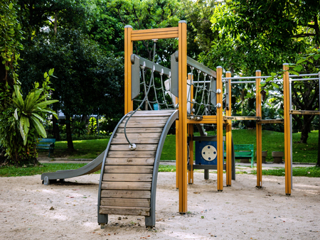 multi station wooden playground. with slide, climb and hang Reklamní fotografie
