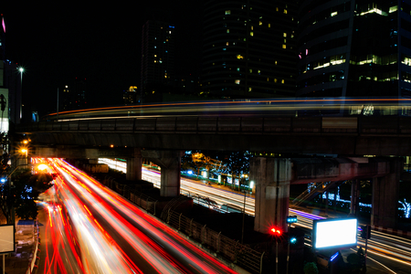 Car and skytrain light trails with slow shutter night shot in bangkok